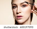 close up face of a girl making... | Shutterstock . vector #600197093