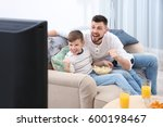 father and son watching... | Shutterstock . vector #600198467