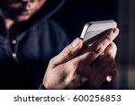 hooded cyber crime hacker using ... | Shutterstock . vector #600256853