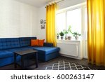 clean family room with blue... | Shutterstock . vector #600263147