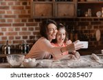 'happy mother and daughter with ... | Shutterstock . vector #600285407