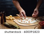 chef cooking pizza  putting... | Shutterstock . vector #600391823