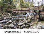 a wood bridge with a waterwheel ...   Shutterstock . vector #600438677
