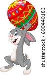 cartoon rabbit carrying easter... | Shutterstock .eps vector #600440183