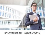 confident businesswoman holding ... | Shutterstock . vector #600529247