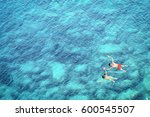 above view of couple snorkeling ... | Shutterstock . vector #600545507