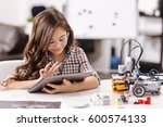 amused teen girl using tablet... | Shutterstock . vector #600574133