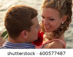 happy couple in love on dating... | Shutterstock . vector #600577487
