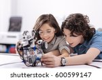 curious kids playing with robot ... | Shutterstock . vector #600599147