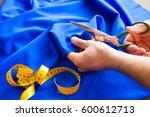 tailor. man hands notch tailor... | Shutterstock . vector #600612713