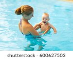 mother and baby swim  in the... | Shutterstock . vector #600627503