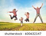 family jumping together in the... | Shutterstock . vector #600632147