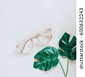 eyeglasses and green palm... | Shutterstock . vector #600632243