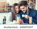 beautiful couple having coffee... | Shutterstock . vector #600693347