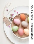 pastel easter eggs on a plate | Shutterstock . vector #600751727