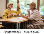 two ladies at cafe table.... | Shutterstock . vector #600755633
