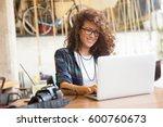 attractive businesswoman using... | Shutterstock . vector #600760673
