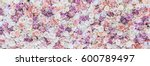 flowers wall background with... | Shutterstock . vector #600789497