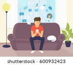 young man sitting on the sofa... | Shutterstock . vector #600932423