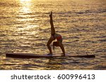 yoga girl over sup stand up... | Shutterstock . vector #600996413