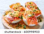 filled eggs with salmon pinchos ... | Shutterstock . vector #600998903