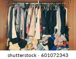pile of messy clothes in closet.... | Shutterstock . vector #601072343