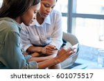 two focused young business... | Shutterstock . vector #601075517