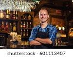 portrait of cheerful barman... | Shutterstock . vector #601113407