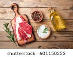 raw meat on wooden background.... | Shutterstock . vector #601150223