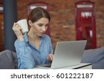 beautiful brunette using laptop ... | Shutterstock . vector #601222187
