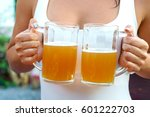 young woman holding mugs with... | Shutterstock . vector #601222703