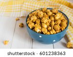 caramel popcorn in cup on white ... | Shutterstock . vector #601238363