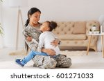 confident caring mom holding... | Shutterstock . vector #601271033