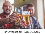 two bearded hipsters clinking... | Shutterstock . vector #601302287