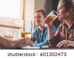 hipster woman drinking beer... | Shutterstock . vector #601302473