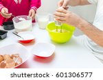 young happy family making food... | Shutterstock . vector #601306577