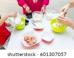 young happy family making food... | Shutterstock . vector #601307057