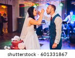 the bride and groom cut and eat ... | Shutterstock . vector #601331867