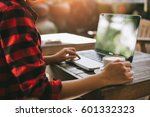 woman typing on notebook...   Shutterstock . vector #601332323