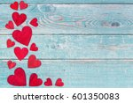 red wooden hearts on the left... | Shutterstock . vector #601350083
