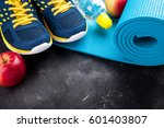 sport shoes  yoga mat  apples ... | Shutterstock . vector #601403807