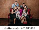 three generation family sitting ... | Shutterstock . vector #601405493