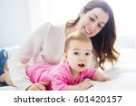 a mother and baby child on a... | Shutterstock . vector #601420157