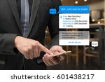 Small photo of Chat bot and future marketing concept . Business man hand holding smartphone look for ticket and popup out smart phone screen with automatic chatbot message screen , coffee shop background