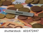 Small photo of dissave - the word was printed on a metal bar. the metal bar was placed on several banknotes