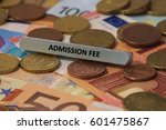Small photo of admission fee - the word was printed on a metal bar. the metal bar was placed on several banknotes