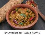 bengali masala chicken curry is ... | Shutterstock . vector #601576943
