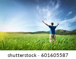 man in green meadow and... | Shutterstock . vector #601605587
