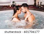beautiful young couple relaxing ... | Shutterstock . vector #601706177