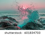 wave hit the rock at beach  sea ... | Shutterstock . vector #601834703